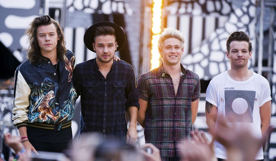 """In this Aug. 4, 2015, file photo, One Direction members, from left, Harry Styles, Liam Payne, Niall Horan and Louis Tomlinson perform on ABC's """"Good Morning America"""" at Rumsey Playfield/SummerStage in New York. (Photo by Charles Sykes/Invision/AP, File)"""