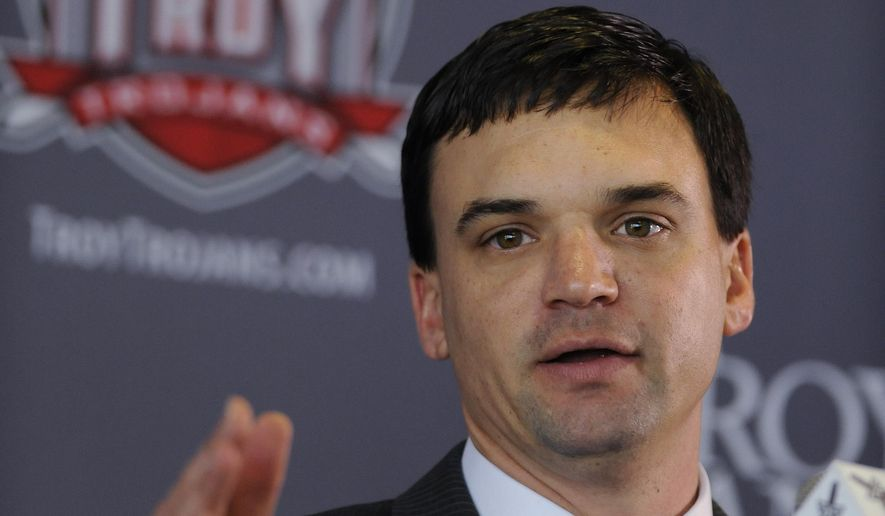 FILE - In this Dec. 1, 2014, file photo, Neal Brown speaks after he is introduced as the new head NCAA college football coach at Troy University in Troy, Ala. rown enters his first season as Troy's coach with long-term aspirations of restoring the program to where it was when he was offensive coordinator.  (AP Photo/The Montgomery Advertiser, Mickey Welsh, File)  NO SALES
