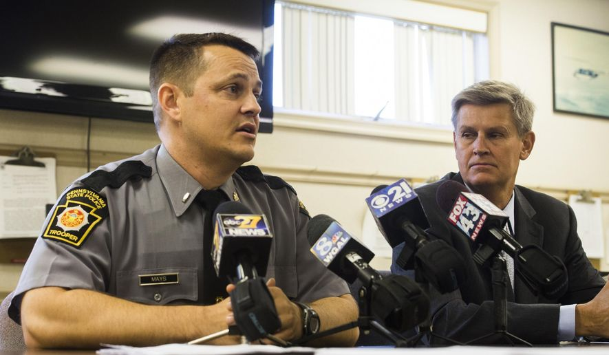 Pennsylvania State Police Lt. Jonathan Mays, left, and Adams County District Attorney Shawn C. Wager speak during a news conference, Tuesday, Aug. 18, 2015, at the Pennsylvania State Police barracks in Gettysburg, Pa., regarding two counts of criminal homicide filed against 54-year-old Abraham Cruz Jr. in connection with the Aug. 30, 1980, deaths of a mother and her daughter. Prosecutors say Cruz shot and killed 17-year-old Deborah Patterson and her mother, Nancy Patterson, during an early morning burglary at their home in Freedom Township, Adams County, near Gettysburg. (Shane Dunlap/The Evening Sun via AP) MANDATORY CREDIT