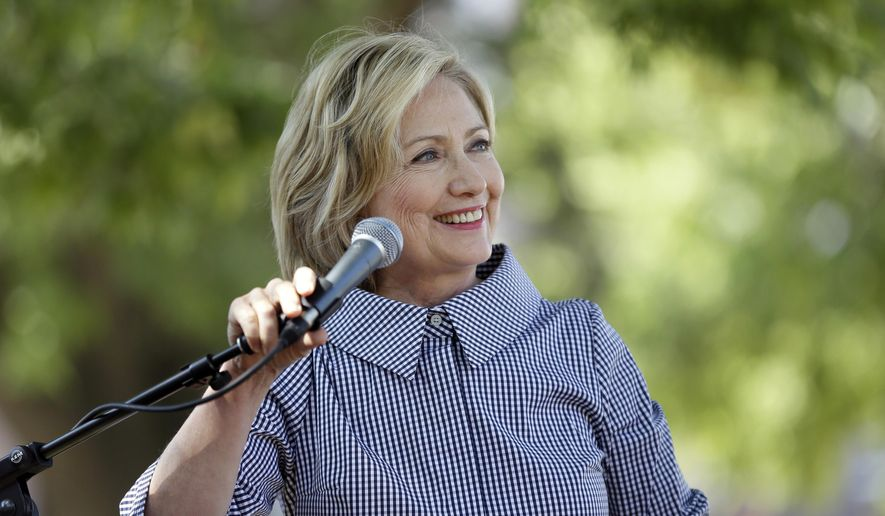 Democratic presidential candidate Hillary Rodham Clinton speaks during a news conference during a visit to the Iowa State Fair, Saturday, Aug. 15, 2015, in Des Moines, Iowa. (AP Photo/Charlie Neibergall)