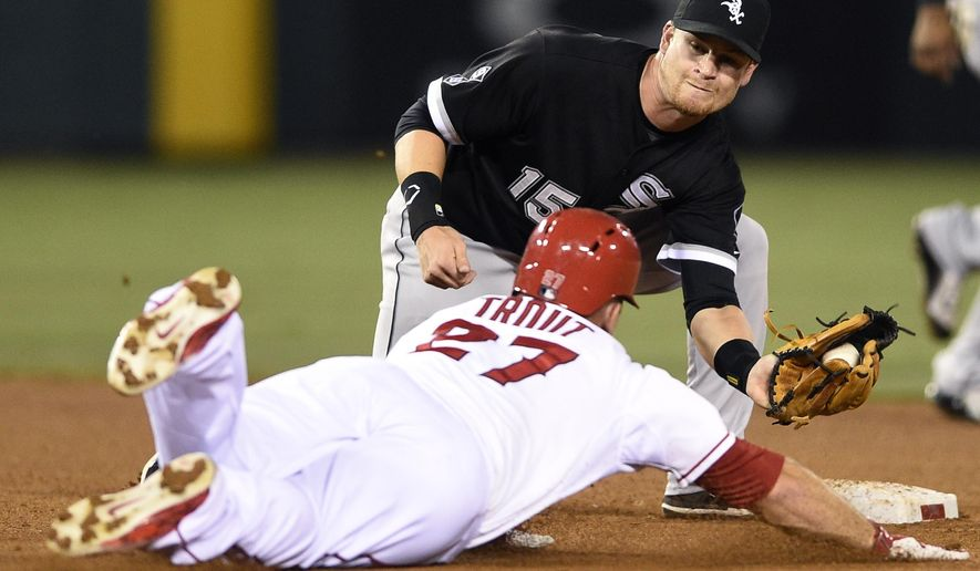 Chicago White Sox second baseman Gordon Beckham, top, tags out Los Angeles Angels' Mike Trout, bottom, as he attempts to steal second after during the fourth inning of a baseball game in Anaheim, Calif., Monday, Aug. 17, 2015. (AP Photo/Kelvin Kuo)