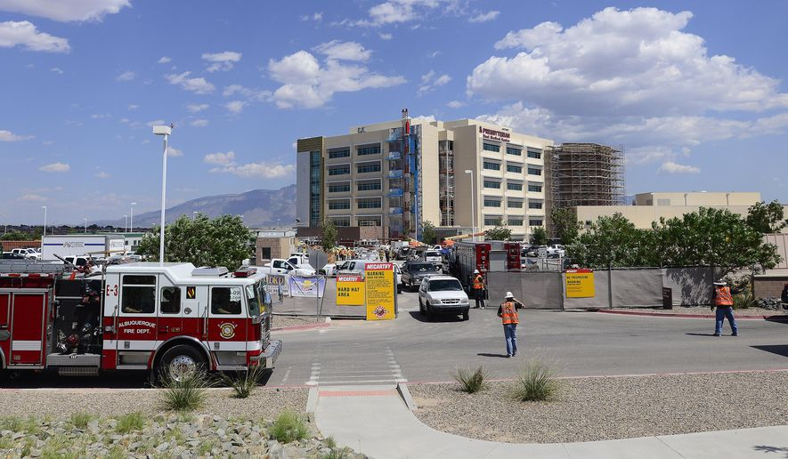 Emergency crews respond to a scaffolding accident at the Presbyterian Rust Medical Center in Rio Rancho, N.M., Tuesday Aug. 18, 2015.  Officials at Presbyterian Rust Medical Center say 21 feet of scaffolding buckled and collapsed from the top down Tuesday afternoon. (Adolphe Pierre-Louis/The Albuquerque Journal via AP)