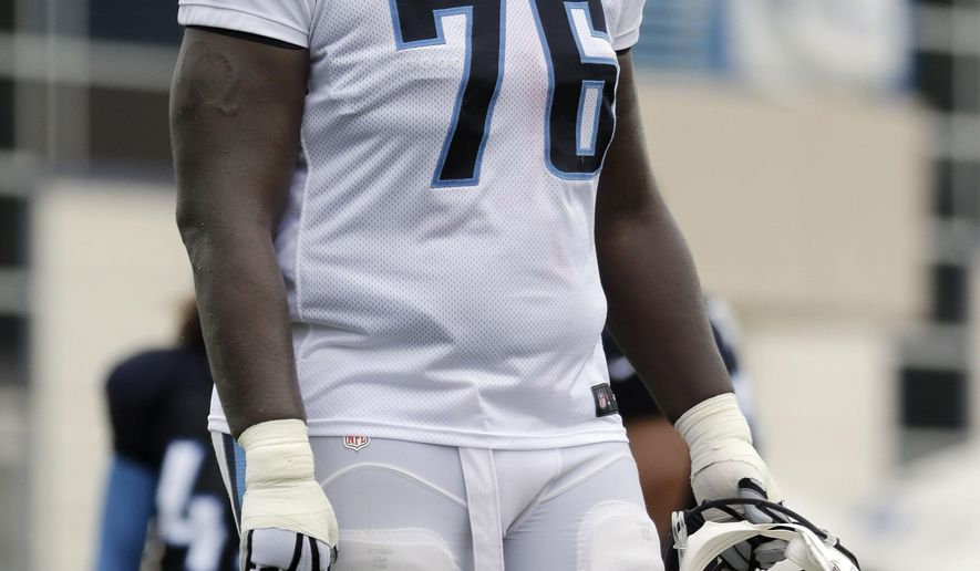 In this Aug. 5, 2015 photo, Tennessee Titans tackle Byron Bell takes a break during NFL football training camp in Nashville, Tenn. The Titans find themselves shuffling the offensive line around and Bell is getting work at left guard. (AP Photo/Mark Humphrey)