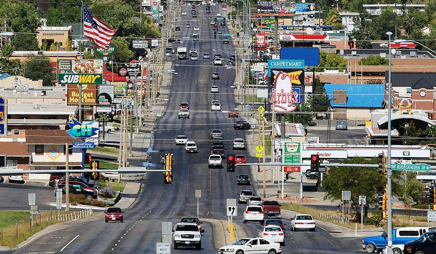 In this photo taken Sept. 18, 2012, traffic moves along Mount Rushmore Road in Rapid City, S.D. An advocacy group for Mount Rushmore Road merchants and landowners has asked the Rapid City Council to spend another $1 million to further beautify the corridor as the state reconstructs the road. The city already has approved spending about $5 million to spruce up the road as part of a joint city-state road reconstruction project that will cost more than $24 million by the time it's complete in 2018. (Chris Huber/Rapid City Journal via AP) TV OUT; MANDATORY CREDIT