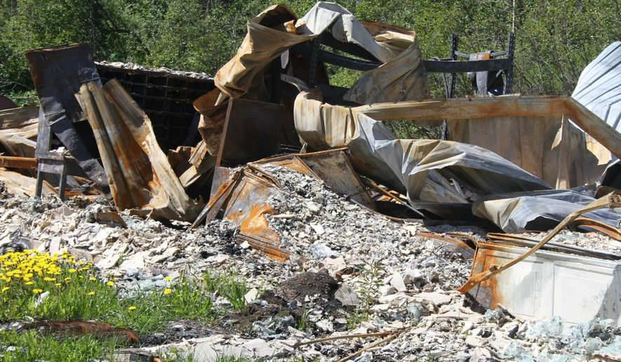 This photo taken June 13, 2015, shows rubble from the Motherlode Lodge near Palmer, Alaska, which was destroyed by a fire in April 2015. The rubble is being cleared, and an artist will use some artifacts from the destroyed lodge to create some type of artwork to sit at the lodge site in Hatcher Pass. (AP Photo/Mark Thiessen)