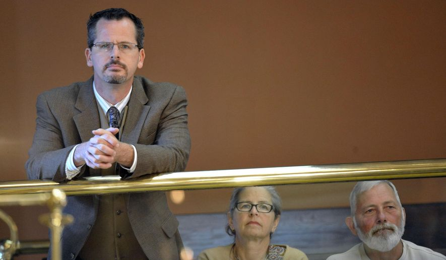 State Rep. Todd Courser, R-Lapeer,  watches  morning session of the Michigan House of Representatives from the gallery with his parents, Georgeann and Dan Courser, Tuesday, Aug. 18, 2015, in Lansing, Mich.. Courser and fellow house republican Rep. Cindy Gamrat, R-Plainwell, two first-term Michigan lawmakers, are under fire for an extramarital relationship and fictional email.  (Dale G. Young/Detroit News via AP)  DETROIT FREE PRESS OUT; HUFFINGTON POST OUT; MANDATORY CREDIT
