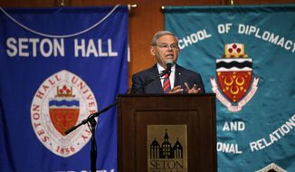 Sen. Bob Menendez addresses  a gathering at Seton Hall University, Tuesday, Aug. 18, 2015, in South Orange, N.J. Menendez announced on Tuesday his opposition to the Iran nuclear deal, the second Democratic senator to go against President Barack Obama, who is heavily lobbying for a congressional endorsement of the agreement. Menendez, a senior member of the Senate Foreign Relations Committee, joins Sen. Chuck Schumer of New York in rejecting the deal. (AP Photo/Mel Evans)