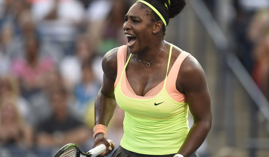 Serena Williams, of the United States, reacts to winning a point in the second set against Belinda Bencic, of Switzerland, during the Rogers Cup semifinal tennis tournament, Saturday, Aug. 15, 2015 in Toronto. (Frank Gunn/The Canadian Press via AP) MANDATORY CREDIT
