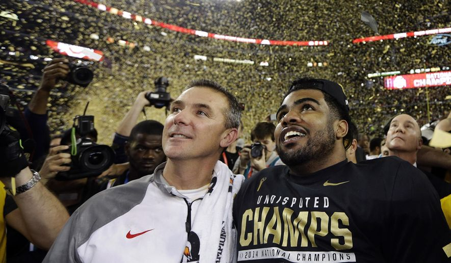 FILE - In this Jan. 12, 2015, file photo, Ohio State head coach Urban Meyer, left, and Ezekiel Elliott celebrate after they defeated Oregon 42-20 in the NCAA college football playoff championship game in Arlington, Texas. Ezekiel Elliott and the Ohio State offensive line could make most quarterbacks look good. For all the headlines generated by the Buckeyes' ability to replace a star quarterback with another star quarterback last season, the development of running game was every bit as important to Ohio State's national championship season.  (AP Photo/David J. Phillip, File)