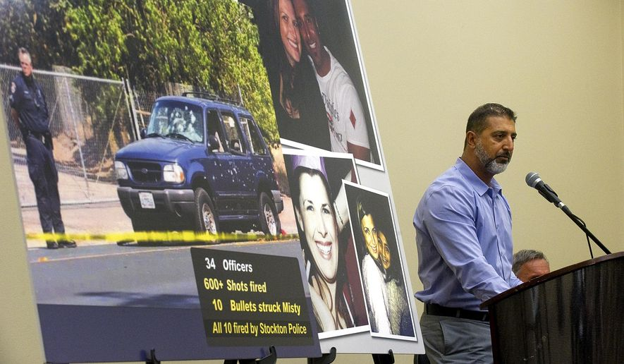 Paul Singh speaks at a news conference, Tuesday, Aug. 18, 2015, in Stockton, Calif., announcing the filing of a lawsuit against the Stockton Police Department in the death of his wife Misty Holt-Singh. Holt-Singh was shot and killed by police after being taken hostage during a bank robbery in July 2014. (Clifford Oto/The Record via AP) MAGS OUT; MANDATORY CREDIT