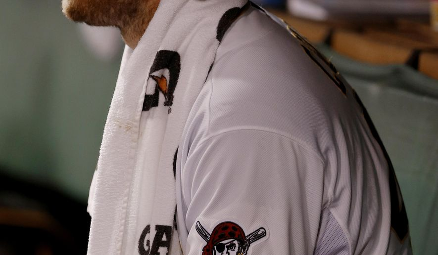 Pittsburgh Pirates starting pitcher Gerrit Cole sits in the dugout as his team bats in the fourth inning of a baseball game against the Arizona Diamondbacks, Monday, Aug. 17, 2015, in Pittsburgh. (AP Photo/Keith Srakocic)