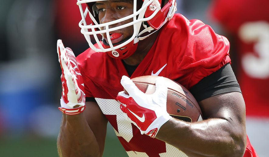 FILE - In this Aug. 4, 2015, file photo, Georgia running back Nick Chubb runs the ball during a NCAA college football practice in Athens, Ga. Chubb says he's confident in each of the three contenders in Georgia's quarterback race.  (AP Photo/John Bazemore, File)