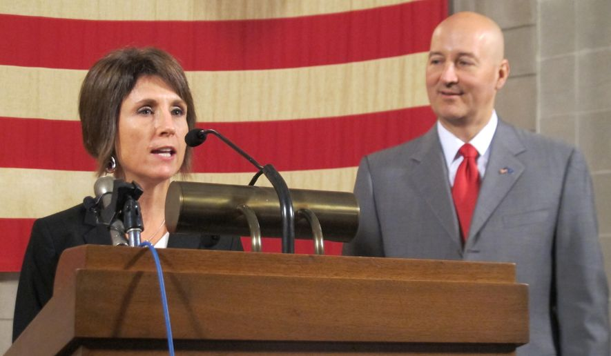 Nicole Fox of Omaha answers media questions with Gov. Pete Ricketts at her side on Tuesday, Aug. 18, 2015, at the State Capitol in Lincoln, Neb. Ricketts announced that he has chosen Fox to fill a seat in the Legislature that came open when former state Sen. Jeremy Nordquist of Omaha resigned. (AP Photo/Grant Schulte)