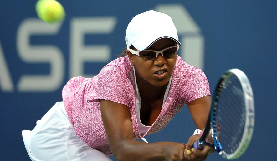 FILE - In this Aug. 29, 2013, file photo, Victoria Duval of the United States, stretches for a backhand return against Daniela Hantuchova of Slovakia at the U.S. Open Tennis tournament in New York. Duval has received a wild-card entry for U.S. Open qualifying after recently returning to competition following a yearlong recovery from Hodgkin's lymphoma. (AP Photo/Kathy Kmonicek, File)
