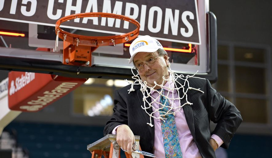 FILE - In this March 8, 2015, file photo, Coastal Carolina coach Cliff Ellis poses after cutting the net at the end of the Big South Conference Championship NCAA college basketball game against Winthrop, in Conway, S.C. Cliff Ellis is accustomed to making history in college basketball. He and his Coastal Carolina team got to see some up close last week during their preseason trip to Cuba, which ended with the team watching the U.S. flag raised over the American embassy for the first time in more than a half century. (AP Photo/Richard Shiro, File)