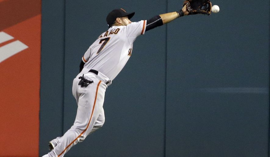 San Francisco Giants center fielder Gregor Blanco can't reach a ball hit for a triple by St. Louis Cardinals' Stephen Piscotty during the eighth inning of a baseball game Monday, Aug. 17, 2015, in St. Louis. (AP Photo/Jeff Roberson)