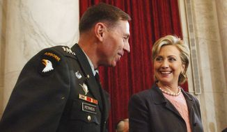 Then-Sen. Hillary Rodham Clinton, New York Democrat talks with Lt. Gen. David Petraeus on Capitol Hill on Jan. 23, 2007. (Associated Press)