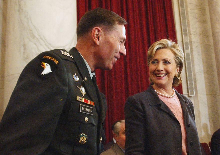 Then-Sen. Hillary Rodham Clinton, New York Democrat talks with Lt. Gen. David Petraeus on Capitol Hill on Jan. 23, 2007. (Associated Press)