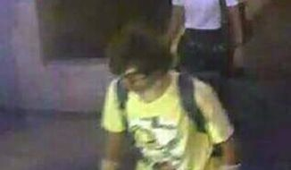 This Aug. 17, 2015, image, released by Royal Thai Police spokesman Lt. Gen. Prawut Thavornsiri shows a man wearing a yellow T-shirt near the Erawan Shrine before an explosion occurred in Bangkok, Thailand. Prawut said he believes the man is a suspect in the blast that killed a number of people at a shrine in downtown Bangkok on Monday night. (Royal Thai Police via AP)