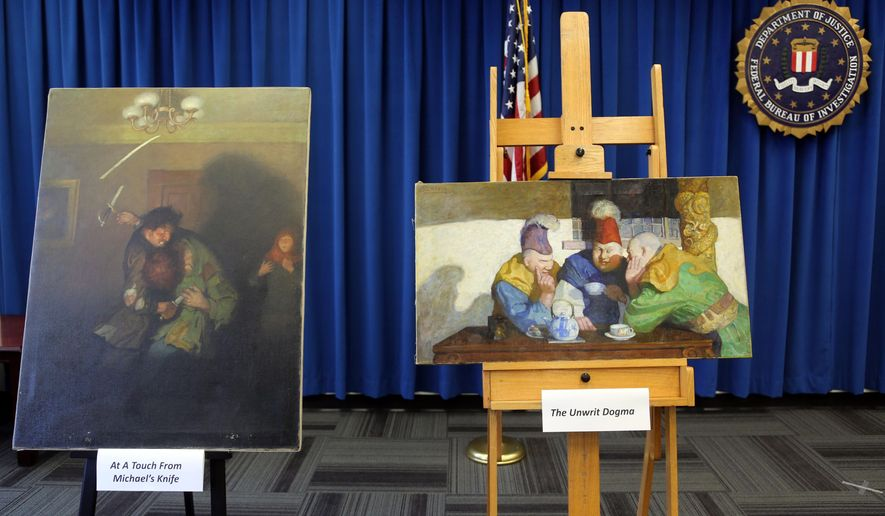 Michael's Knife, left, and The Unwrit Dogma paintings by N.C. Wyeth are displayed during an FBI news  conference in Los Angeles on Tuesday, Aug. 18, 2015 to announce in the investigation into the theft of valuable art stolen in 2013. The FBI is offering a reward of up to $20,000 for help in finding two N.C. Wyeth paintings stolen from a home in Portland, Maine. Four were recovered from a pawn shop in Beverly Hills, California, in December, and are estimated to be worth up to $2 million. But the remaining two were never found. (AP Photo/Nick Ut)