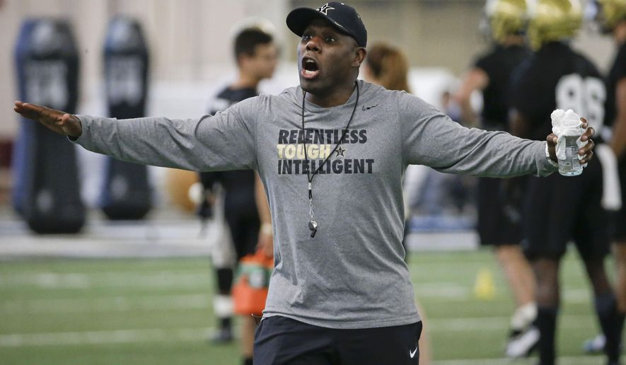 FILE -- In this Aug. 6, 2015, file photo, Vanderbilt head coach Derek Mason leads an NCAA college football practice in Nashville, Tenn. In his second season, Mason hopes to improve on last year's 3-9 record, failing to win even one game in the Southeastern Conference. (AP Photo/Mark Humphrey, File)