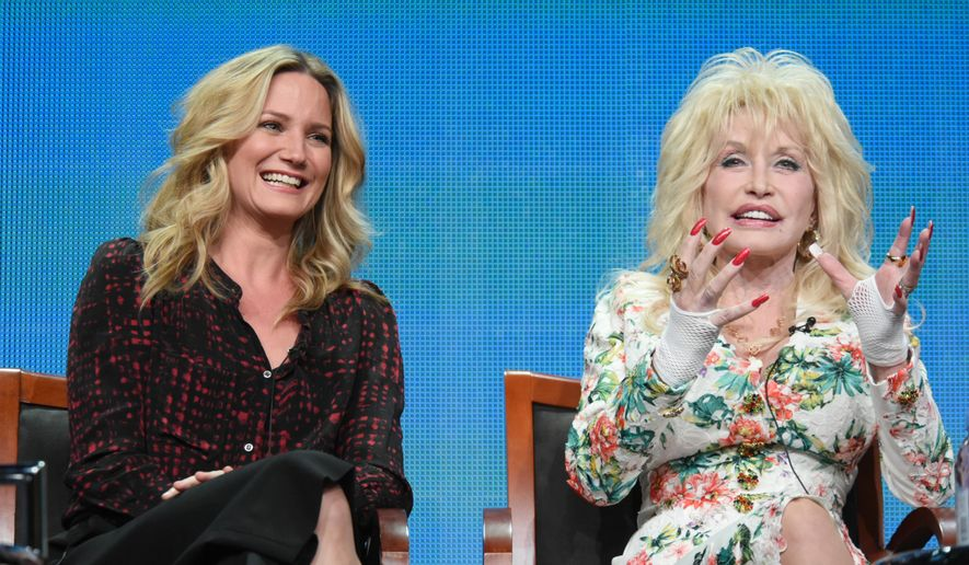 "FILE - In this Thursday, Aug. 13, 2015 file photo, Jennifer Nettles, left, and Dolly Parton participate in the ""Dolly Parton's Coat of Many Colors"" panel at the NBCUniversal Television Critics Association Summer Tour at the Beverly Hilton Hotel in Beverly Hills, Calif. NBC announced that the upcoming holiday film will air Thursday, Dec. 10, 2015, 9-11 p.m. ET/PT.  (Photo by Richard Shotwell/Invision/AP, File)"