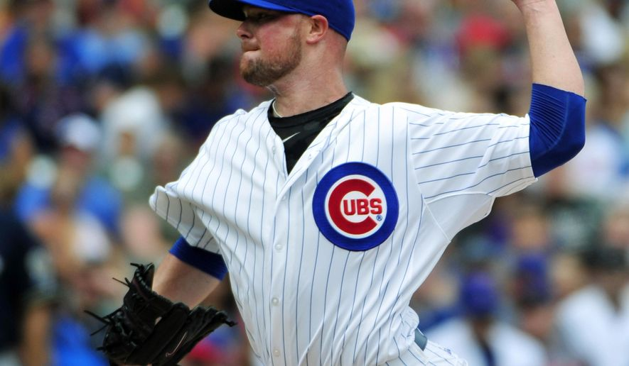 Chicago Cubs starting pitcher Jon Lester (34) throws against the Milwaukee Brewers during the first inning of a baseball game, Thursday, Aug. 13, 2015, in Chicago. (AP Photo/David Banks)