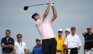 Jim Furyk hits on the 15th hole during the first round of the PGA Championship golf tournament Thursday, Aug. 13, 2015, at Whistling Straits in Haven, Wis. (AP Photo/Julio Cortez)