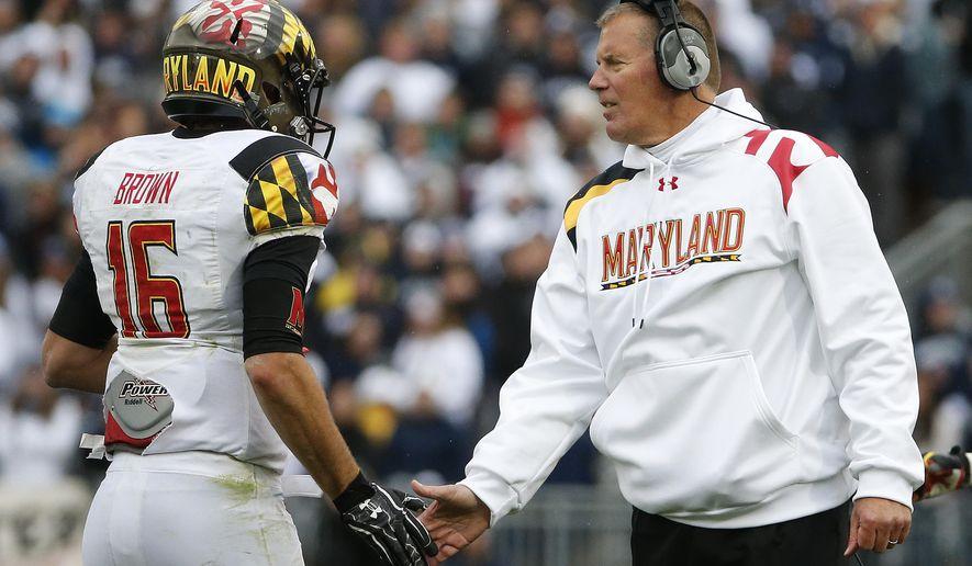 FILE - In this Nov. 1, 2014 file photo, Maryland head coach Randy Edsall, right, greets quarterback C.J. Brown as he returns to the sideline after throwing a touchdown pass during an NCAA college football game against Penn State in State College, Pa. The Maryland Terrapins know exactly what must happen if they are to pull off a sufficient encore to their surprisingly successful debut in the Big Ten. (AP Photo/Gene J. Puskar, File)
