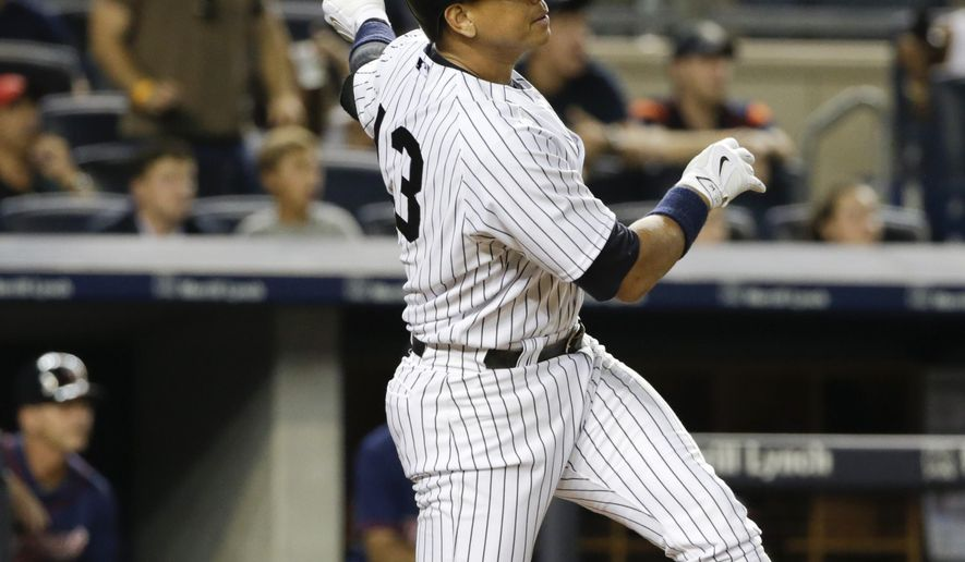 New York Yankees' Alex Rodriguez follows through on a grand slam during the seventh inning of a baseball game against the Minnesota Twins on Tuesday, Aug. 18, 2015, in New York. (AP Photo/Frank Franklin II)