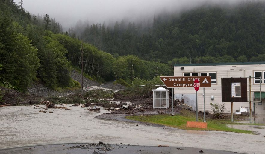 The Gary Paxton Industrial Park Administration Building is surrounded by rain water, mud and debris after landslides Tuesday, Aug. 18, 2015 in SItka, Alaska.  Four residents of a neighborhood in Alaska were missing Tuesday after heavy rain caused several landslides, emergency responders said. (James Poulson/The Daily Sitka Sentinel via AP) MANDATORY CREDIT