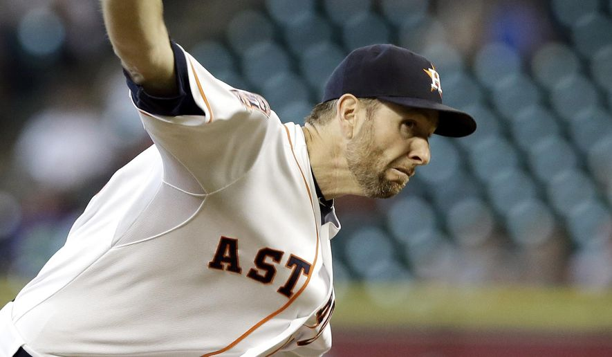 Houston Astros' Scott Feldman delivers a pitch against the Tampa Bay Rays during the first inning of a baseball game Tuesday, Aug. 18, 2015, in Houston. (AP Photo/Pat Sullivan)