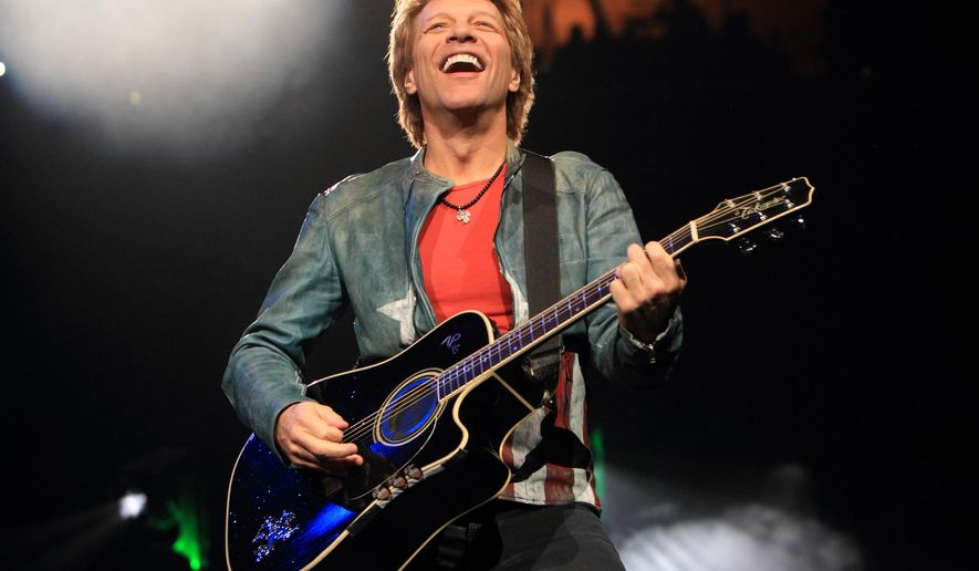 FILE - In this Nov. 5, 2013, file photo, Jon Bon Jovi performs in concert with his band Bon Jovi in Philadelphia. A Bon Jovi concert scheduled for Saturday, Aug. 22, 2015, in Vancouver, British Columbia, has been canceled after the city said the promoter had failed to obtain the required permits. (Photo by Owen Sweeney/Invision/AP, File)