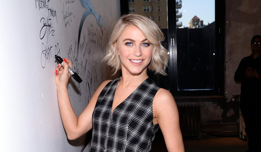 """FILE - In this March 2, 2015, file photo, Julianne Hough poses backstage at AOL Studios in New York. Two-time """"Dancing With the Stars"""" champion Julianne Hough and Washington Capitals forward Brooks Laich say they are planning to get married. Laich and Hough each tweeted the same message Tuesday, Aug. 18, 2015: """"We are overwhelmed with joy and excitement to share with you our recent engagement! (hash)fiance (hash)love""""  (Photo by Evan Agostini/Invision/AP, File)"""