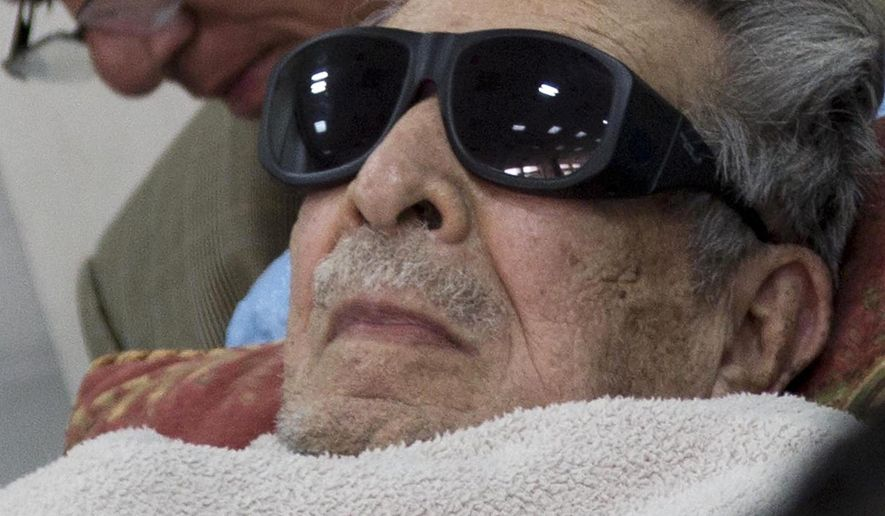 FILE - In this Jan. 5, 2015 file photo, Guatemala's former dictator Jose Efrain Rios Montt arrives on a gurney wearing sunglasses to court where he faces charges of genocide and crimes against humanity in Guatemala City. A Guatemalan court overseeing the genocide case against former dictator Efrain Rios Montt has heard testimony Tuesday, Aug. 18, 2015, that he suffers from dementia. (AP Photo/Luis Soto, File)