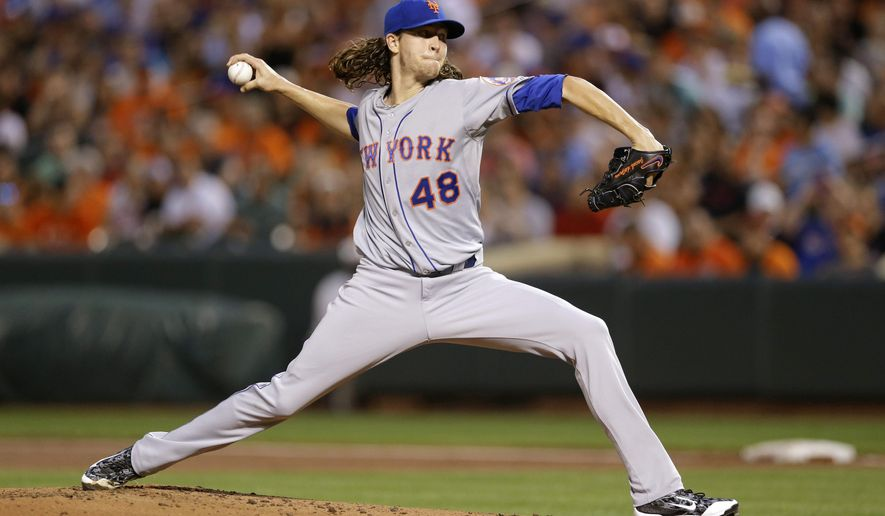 New York Mets starting pitcher Jacob deGrom throws to the Baltimore Orioles in the first inning of a baseball game, Tuesday, Aug. 18, 2015, in Baltimore. (AP Photo/Patrick Semansky)