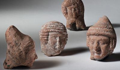 This handout photo provided by the Israel Antiquities Authority (IAA) shows pottery heads of 'pillar' figurines, Jerusalem and other Judean sites. Iron Age II , 8th-6th century BCE. The Museum of the Bible, now under construction in Washington, will feature ancient artifacts and treasures from the Holy Land under a new deal with the Israel Antiquities Authority. (Israel Antiquities Authority/Meidad Suchowolski via AP