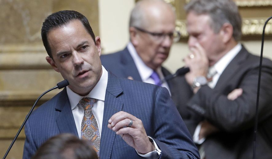 Kaysville Republican Rep. Brad Wilson, co-chair of the prison commission, speaks to the House of Representatives while they take up a controversial proposal to relocate the state prison near Salt Lake City's airport during the Legislature's one-day special session Wednesday, Aug. 19,  2015, in Salt Lake City. Utah lawmakers on Wednesday voted to build a new state prison near Salt Lake City's airport. (AP Photo/Rick Bowmer)