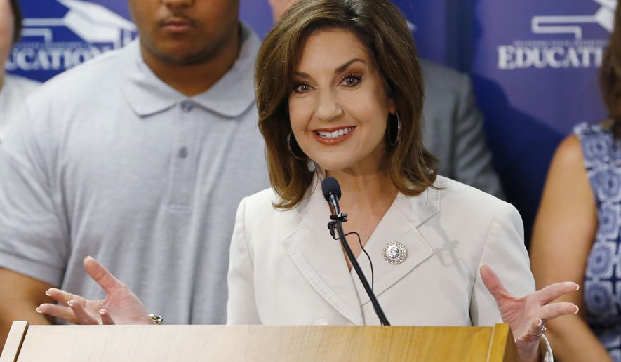 State Superintendent Joy Hofmeister gestures as she speaks at a news conference in Oklahoma City, Wednesday, Aug. 19, 2015. Hofmeister announced a $1.5 million program which will allow every high school junior in Oklahoma to have the opportunity to take the ACT college-preparatory test free of charge under a pilot program being launched by state education officials. (AP Photo/Sue Ogrocki)