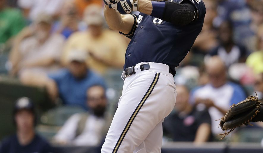 Milwaukee Brewers' Ryan Braun follows through on a home run against the Miami Marlins during the sixth inning of a baseball game Wednesday, Aug. 19, 2015, in Milwaukee. Braun became the franchise's all-time home-run leader. (AP Photo/Jeffrey Phelps)