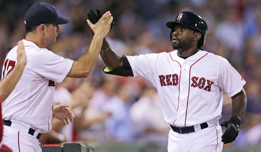 Boston Red Sox's Jackie Bradley Jr., right, is congratulated by Boston Red Sox interim manager Torey Lovullo after his three-run home run off Cleveland Indians starting pitcher Corey Kluber during the fourth inning of a baseball game at Fenway Park in Boston, Wednesday, Aug. 19, 2015. (AP Photo/Charles Krupa)