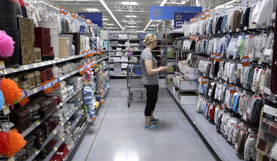 In this June 4, 2015 photo, a customer shops for home accessories at a Wal-Mart Supercenter store in Springdale, Ark. The Labor Department releases its Consumer Price Index for July on Wednesday, Aug. 19, 2015. (AP Photo/Danny Johnston)