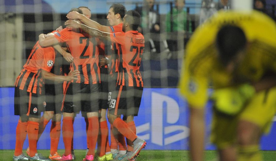 Shakhtar's players celebrate after scoring during their UEFA Champions League play-off first leg soccer match between SK Rapid Wien and FC Shakhtar Donetsk in Vienna, Austria, Wednesday, Aug. 19, 2015. (AP Photo/Hans Punz)