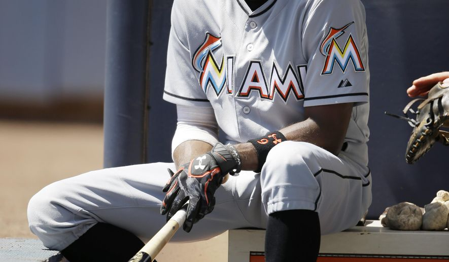Miami Marlins' Dee Gordon waits to bat in the first inning of a baseball game against the Milwaukee Brewers, Wednesday, Aug. 19, 2015, in Milwaukee. (AP Photo/Jeffrey Phelps)