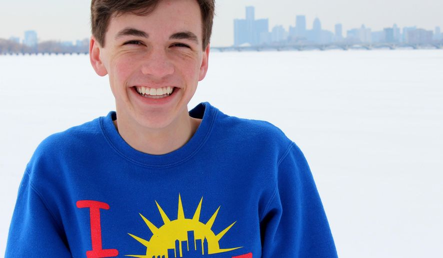 In this undated photo provided by Jake Zelinsk, he poses for a photo with the Detroit skyline in the background. Marquette University announced Wednesday, Aug. 19, 2015, that Jake will be the first recipient of a Marquette, Wis., University scholarship named after executed U.S. journalist James Foley. (Courtesy Carol Zelinski/Jake Zelinsk via AP)