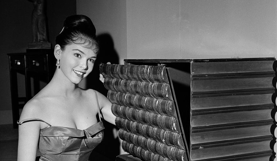"n this July 11, 1959, file photo, actress Yvonne Craig poses on the set of ""The Gene Krupa Story,"" in Los Angeles. Craig, who played the sexy, crime-fighting Batgirl in the 1960s TV hit ""Batman,"" died Monday, Aug. 17, 2015. She was 78. Craig died in her Los Angeles home from complications from breast cancer. (AP Photo/David F. Smith, File)"