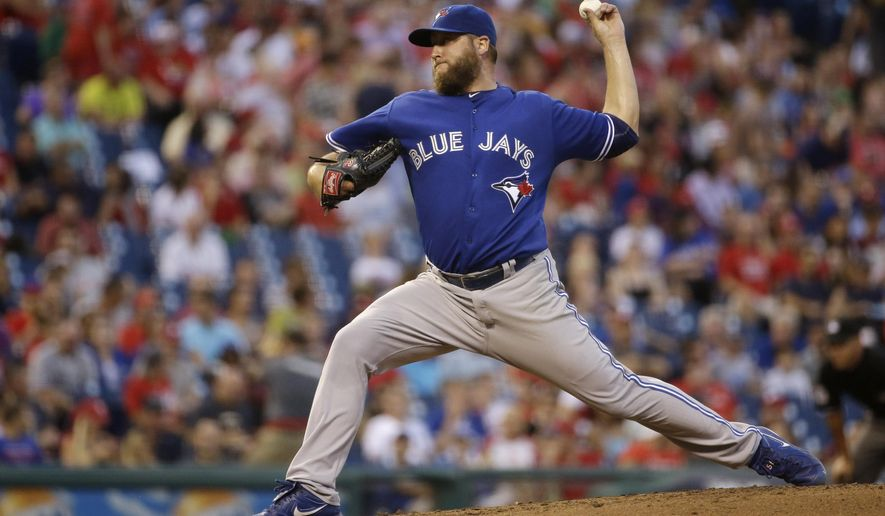 Toronto Blue Jays' Mark Buehrle pitches during the third inning of a baseball game against the Philadelphia Phillies, Wednesday, Aug. 19, 2015, in Philadelphia. (AP Photo/Matt Slocum)