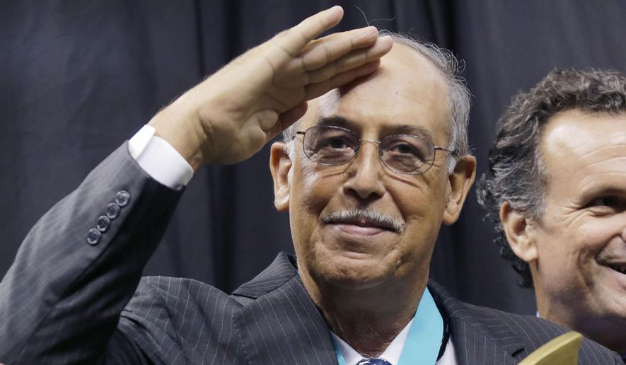 In this Sunday, Sept. 21, 2014, file photo, retired Army Lt. Gen. Russel Honore, who served as commander of Joint Task Force Katrina, salutes as he receives the People's Choice award in the first half of an NFL football game between the New Orleans Saints and the Minnesota Vikings in New Orleans. (AP Photo/Bill Haber) ** FILE **