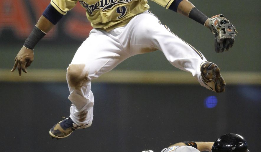 Milwaukee Brewers' Jean Segura (9) forces out Miami Marlins' Cole Gillespie at second base and completes the double play on the Marlins' Adeiny Hechavarria during the sixth inning of a baseball game Tuesday, Aug. 18, 2015, in Milwaukee. (AP Photo/Jeffrey Phelps)
