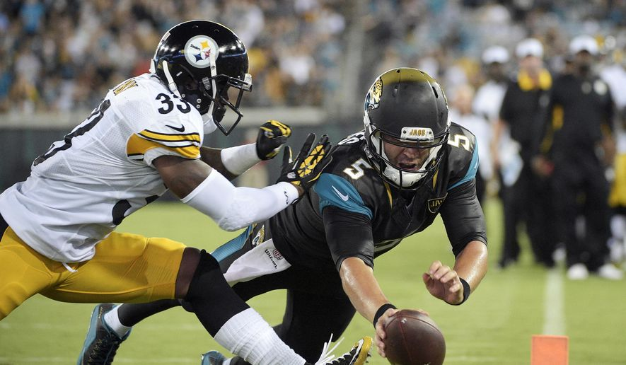 FILE - In this Aug. 14, 2015, file photo, Jacksonville Jaguars quarterback Blake Bortles dives over the goal for a 4-yard touchdown run past Pittsburgh Steelers defensive back Alden Darby (33) during the first half of a preseason NFL football game in Jacksonville, Fla. Bortles delivered a strong showing in the team's preseason opener, completing 11 of 15 passes for 118 yards and running for a touchdown. Now, he looks to double it up at the New York Giants on Saturday.  (AP Photo/Phelan M. Ebenhack, File)